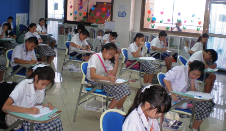 Students taking end of EP term tests in Thailand